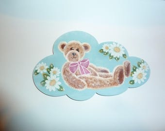 plate with a teddy bear on a cloud with a flower decor