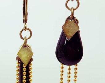 Black asymmetrical earrings