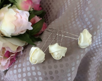 Set of three ivory satin flower hair pins