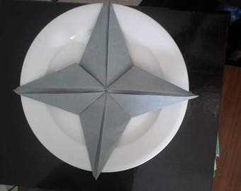 Grey star d shaped napkin folding