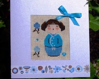 Hand embroidered card: turquoise blue Kokeshi with blue flowers