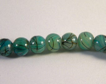 10 pearls glass 6 mm turquoise speckled black TR3 trefilee