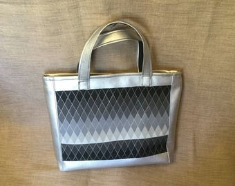 Handbag, black and silver faux leather and fabric.