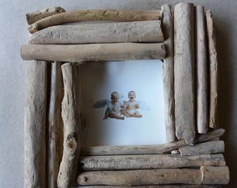 Photo frame with wooden frame beached
