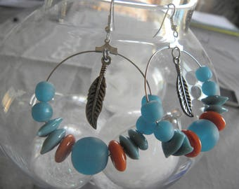 hoop with feather, metal and blue beads