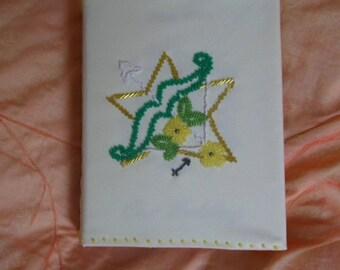 photo album covered in fabric with beaded Sagittarius