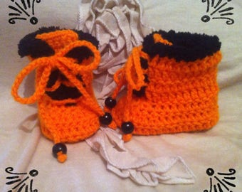 Orange and black baby boots size 3 to 6 months