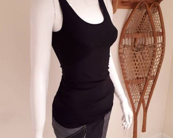 Basic black tank top. This black tank-top is a must-have item. It's machine washable dryer friendly will never pill and looks fantastic on.