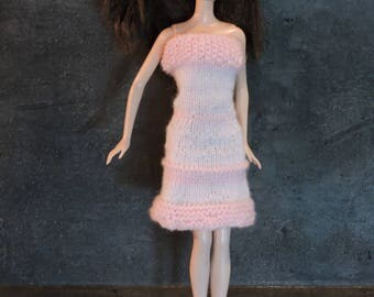 Pale pink and pink sundress supported Barbie