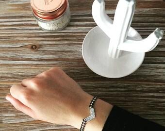Ethnic bracelet with black herringbone chain