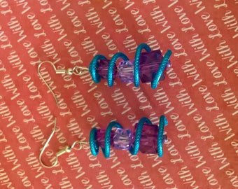 Purple spiral earrings with pearls
