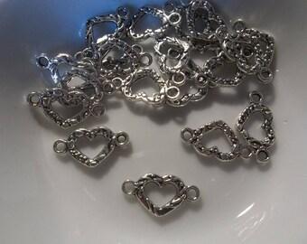Silver heart connectors