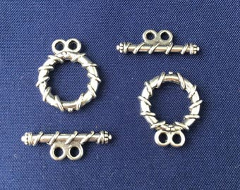 5 sets of 2 snap, toggle clasps, wire wrapped around the circle decor