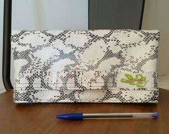 A faux leather snakeskin clutch