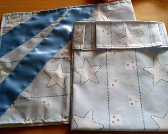 1 set of crib 120 / 60 blue on white star with pillowcase topped with two blue satin ribbons