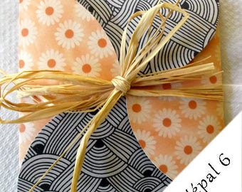 Greeting card orange, black and off-white, which opens as a gift, Nepalese patterns