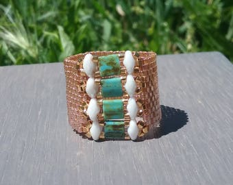 Ring model unique woven manually turquoise white