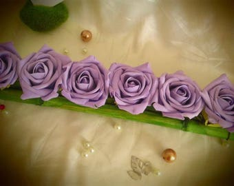 Centerpiece of 9 purple roses and bamboo