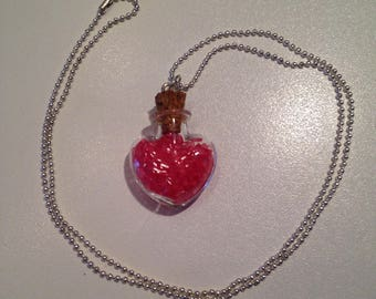 Heart shaped glass vial necklace