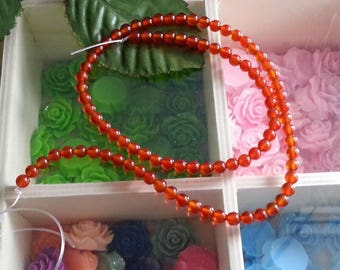 yarn of 100 4 mm, hole 1 mm diameter carnelian beads