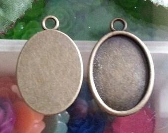 top: 18 x 25 mm support(medium) cabochon. 33 x 21 x 2 mm, hole: 3 mm antique bronze