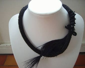 Necklace and its black Peacock feather