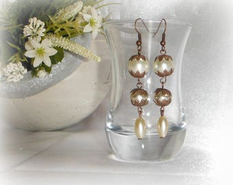 Ivory and copper dangling earrings antiqued