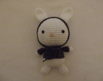 The toy crochet white and dark grey