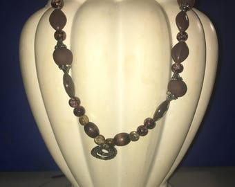 Brown beaded necklace with pendant