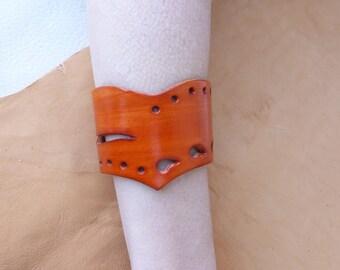Orange bracelet point perforated leather
