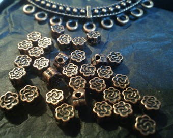Set of 10 flower lead and nickel safe copper pattern beads