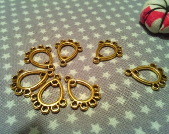 X slots/supports charms 10 antique gold, 7 holes
