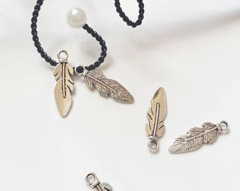 Silver metal feather charm