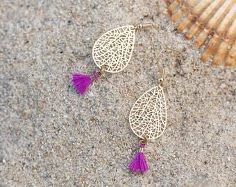 Gold charm and purple tassel earrings