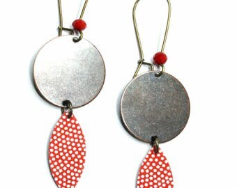 Red earrings with white dots