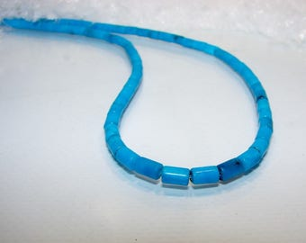 Turquoise tube of 6.30 mm length by width 4.2. Semi-precious stones.