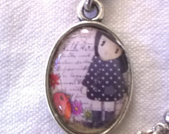 Silver cabochon naïve girl and her bird on writing background