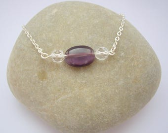 Purple oval bead and transparent beads
