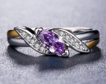 Vintage 18th Century, 925 Silver, Marquise cut Amethyst or Emerald ring with gold band accent.