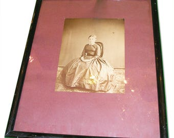 Framed photo of a young woman in dress