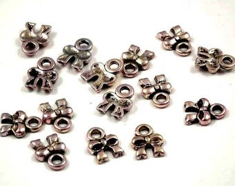 20 X 8mm silver plated bow charms