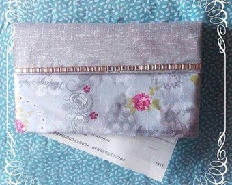Protects checkbook vintage LOVE STORY fabric and quilted for comfort