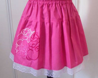 Bright pink embroidered skirt with unicorns