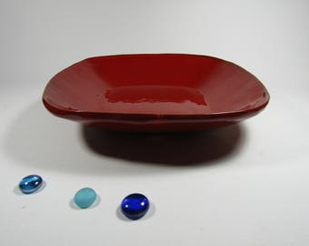 Red rectangular serving dish.