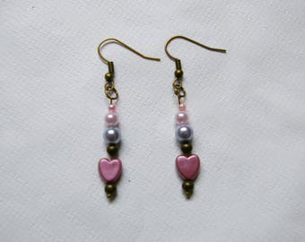 bronze colored metal and pink and purple earrings