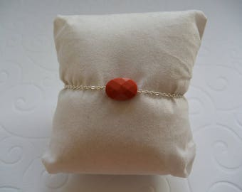 Brick red pillow on a silver chain bracelet