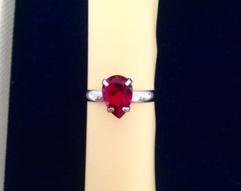 Adjustable ring set with a red Swarovski Crystal PEAR