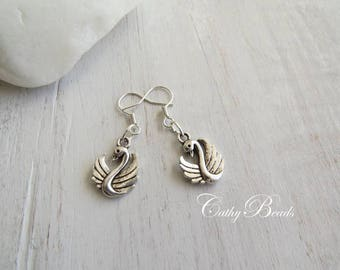 Child earrings in silver and its elegant Swan
