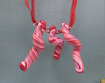 §39§ polymer mounted on muslin & cotton cord twisted necklace