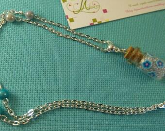 * 21 * vial blue flower pendant